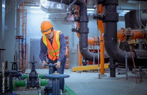 Papel de parede Engineer under checking the industry cooling tower air conditioner is water cooling tower air chiller HVAC of large industrial building to control air system ,wearing mask for protect pollution