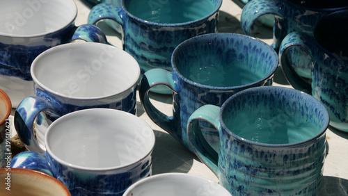 Tela Closeup of handmade ceramic cups for sale