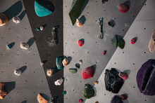 Climbing Equipment On A Wall. Detail View Of Colorful Indoor Climbing Wall. Stock Photo.