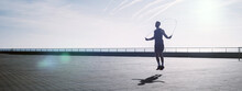 Fit Young Man Skipping With A ...