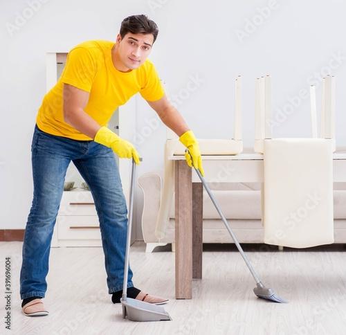 Tela Young man doing chores at home