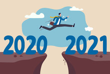 New Year 2021 Hope For Business Recovery, Change Year From 2020 To 2021 Calendar Or New Challenge Coming Concept, Confident Success Businessman Attempt To Jump High Overcome Risk To Next Cliff.