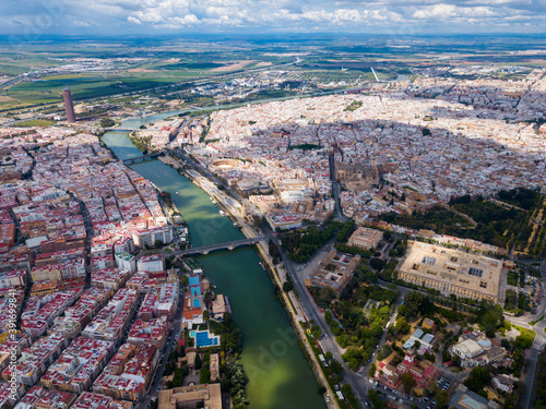 Fotografering Aerial panoramic view of modern cityscape of Seville with Guadalquivir river, Sp