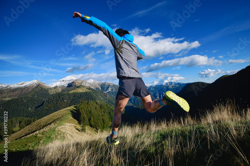 Downhill race on mountain terrain an athlete during a workout Fotobehang