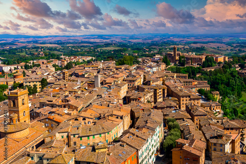 Fototapeta premium Siena beautiful medieval town in Tuscany, Dome and Bell tower of Siena Cathedral, Old Town medieval city of Siena, Tuscany, Italy