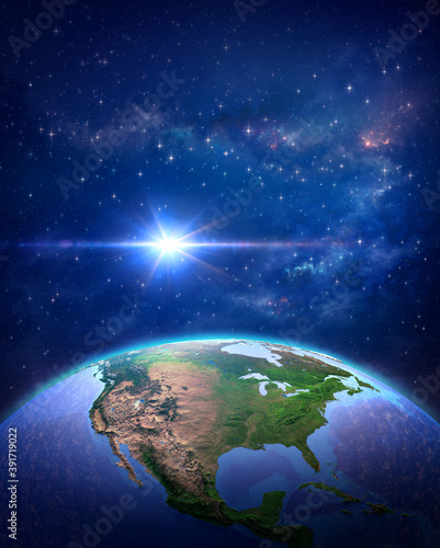 Surface of Planet Earth, space view of the World focused on Europe, galaxies, star cluster, nebula and the Sun shining far behind - Elements of this image furnished by NASA