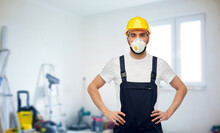Repair, Construction And Building Concept - Male Worker Or Builder In Yellow Helmet And Respirator Over Room With Equipment On Background