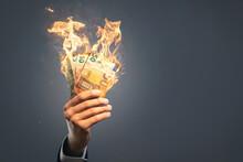 Hand Holding Burning Euro Banknotes