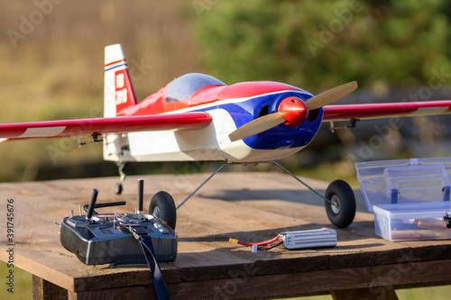 RC plane on a grassy runway