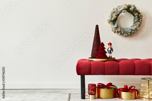 Christmas composition with decoration, christmas tree, gifts, snow and accessories in cozy home decor. Copy space. White and red. Template.