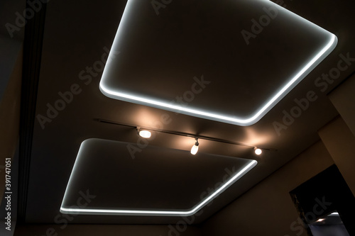 Beautiful stretch ceiling with led lighting. Two squares and lights