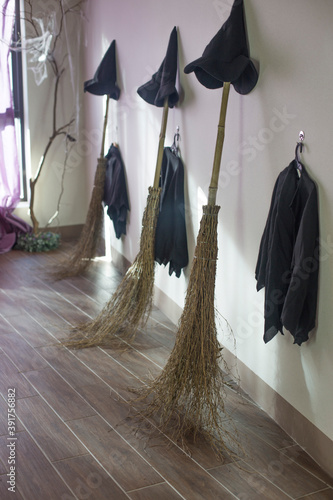 Fotografija Halloween photo with witch hat and clothes with broom.