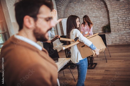 Fotografie, Obraz Business woman carrying packing up all his personal belongings and files into a brown cardboard box to resignation in modern office, resign concept