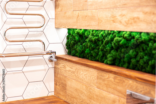 Stampa su Tela Part of the bathroom with wood grain tiles and artificial green moss