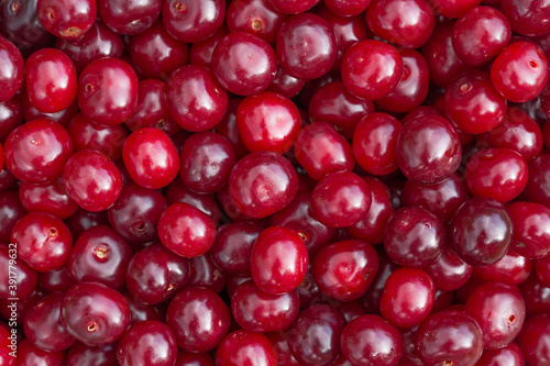Canvastavla Red cherry berries close-up. Natural background from berries.