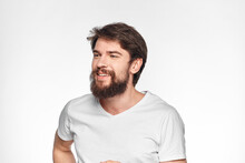 Cheerful Emotional Bearded Man Gesturing With His Hands Close-up Light Background