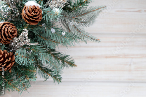 Christmas decorations and pine cones on coniferous branches covered by snow on wooden boards background Fototapet