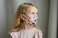 Caucasian Girl Wearing Protective Face Mask Looking Away