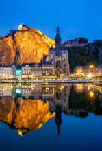 Scenic View Of The Town Dinant Reflected In The River Meuse