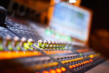 Close Up Of A Mixing Desk With...