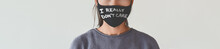 Anti Mask Message I REALLY DONT CARE Text Written On Facial Covering As Silent Protest Banner Panoramic. Unrecognizable Woman Wearing Face Masks.