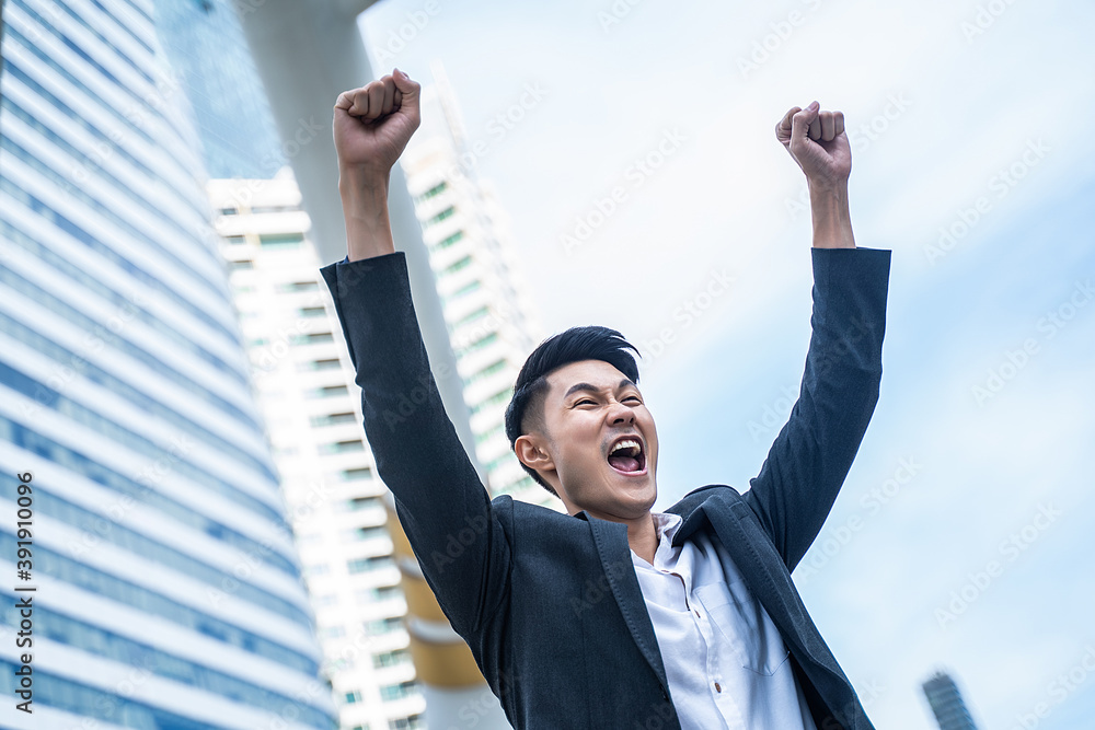 Fototapeta Asian young business man feeling happy and cheerful with new project.