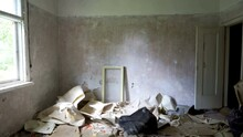 The Scattered Garbage And Rubbles On The Room Of The Abandoned House In The Forest