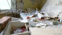 Closer Look Of The Dust On The Room In The Abandoned House With Lots Of Garbage And Rubbles On The Ground