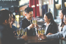 Group Of Asian Friends Enjoying Evening Drinks In Bar. Celebration, Party People Christmas And Happy New Year Concept. Asian Business People In Party.