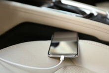 Mobile Phone With Charging Cable In Car, Closeup