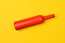 Red Glass Bottle On Yellow Background