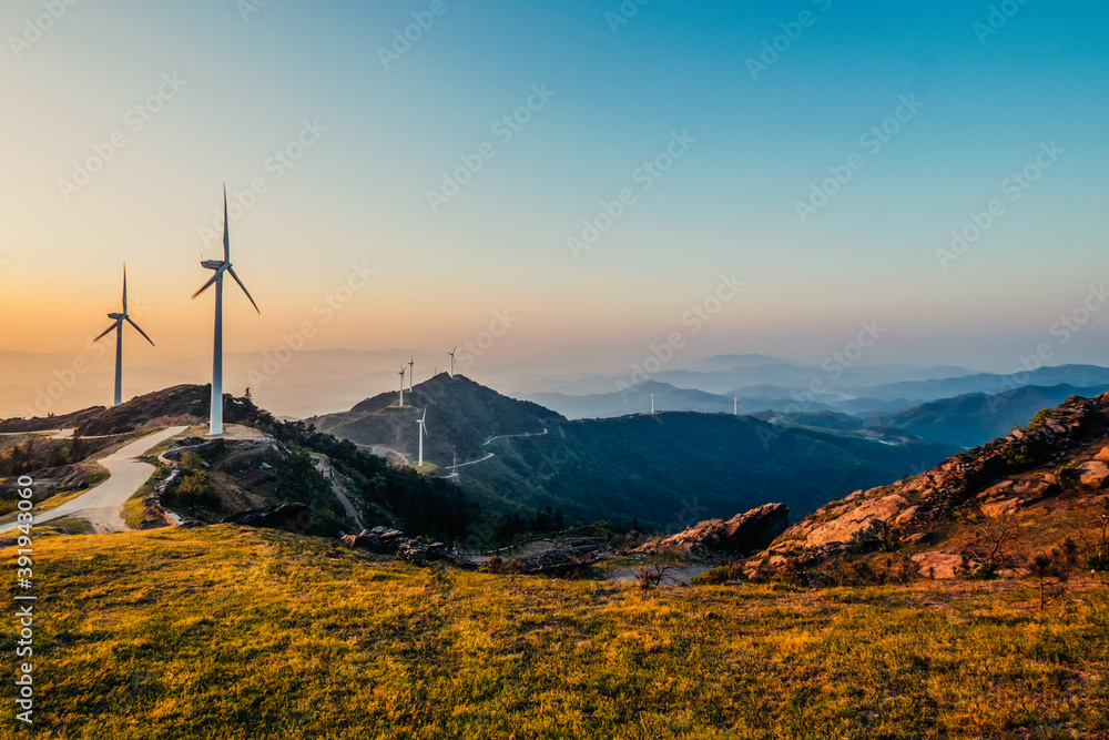 Fototapeta Wind power windmill on top of the mountain