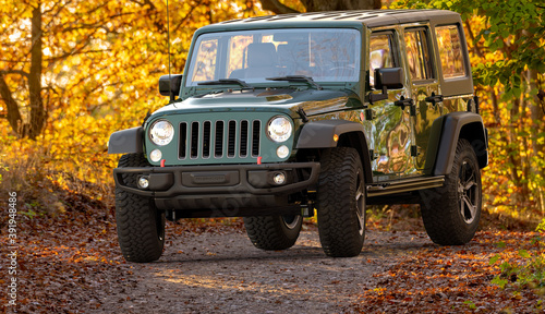 Jeep Wrangler driving a forest road