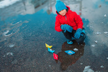 Child Playing With Paper Boats...
