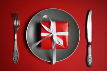 Plate With Cutlery And Gift On...