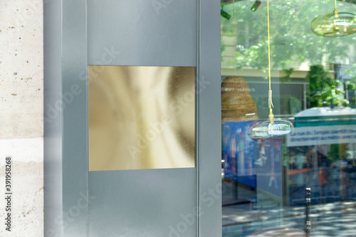 Fototapety, obrazy: Storefront plate on a grey shop door Mockup. Empty store brand signboard frame in street