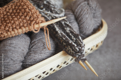 Fotografering Close-up of balls of yarn and needles for knitting the warm scarf