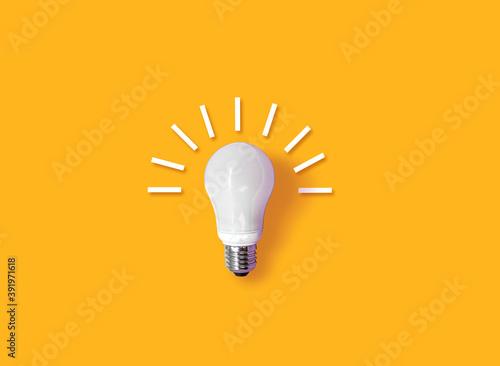 Fotografie, Obraz idea light bulb on orange background