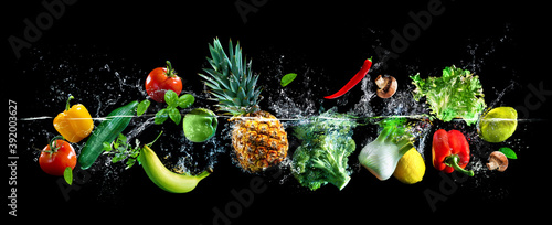 Fotografie, Obraz Fresh vegetables, fruits and water splashes on panoramic background