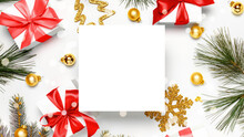 Holiday Winter Background. White Gift Box With Red Ribbon, New Year Balls And Christmas Tree In Xmas Composition On White For Greeting Card. Flat Lay, Top View, Copy Space.