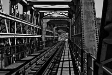 Old Rusted Train Bridge In The Bush Black And White