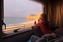 Baby Looking From Campervan Wi...