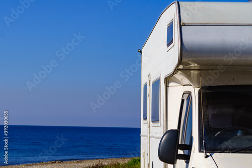 Rv caravan camping on empty beach Canvas
