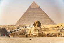 Tourists Visit The Pyramids An...