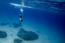 Male Ocean Photographer Holdin...