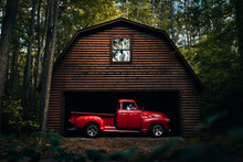 Antique Rustic 1950's Red Truck In A Wooden Log Barn In The Woods
