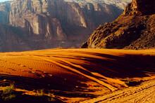 Sunset Across The Sand Dunes And Mountains Of Wadi Rum, Jordan