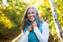 Gray Haired Woman Enjoying A Nature Walk
