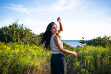 Black Multiracial Woman Lifestyle Portrait By The Ocean At Golden Hour