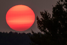 Eastern Sunset Defused And Colored By Western Forest Fire Smoke
